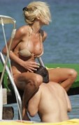Victoria Silvsted with a bikini covering her boobs and a man covering her crotch ... 1 pic