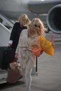 Памела Андерсон, фото 5007. Pamela Anderson arrival at Vienna International Airport, march 4, foto 5007
